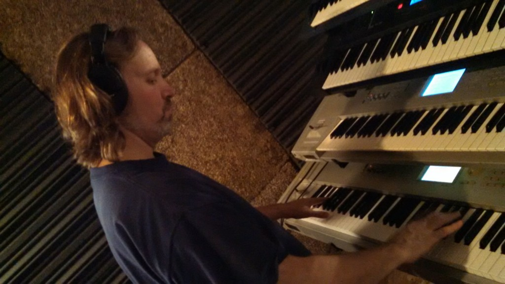 Andrew Colyer lays down rough keyboard tracks in The Cave.