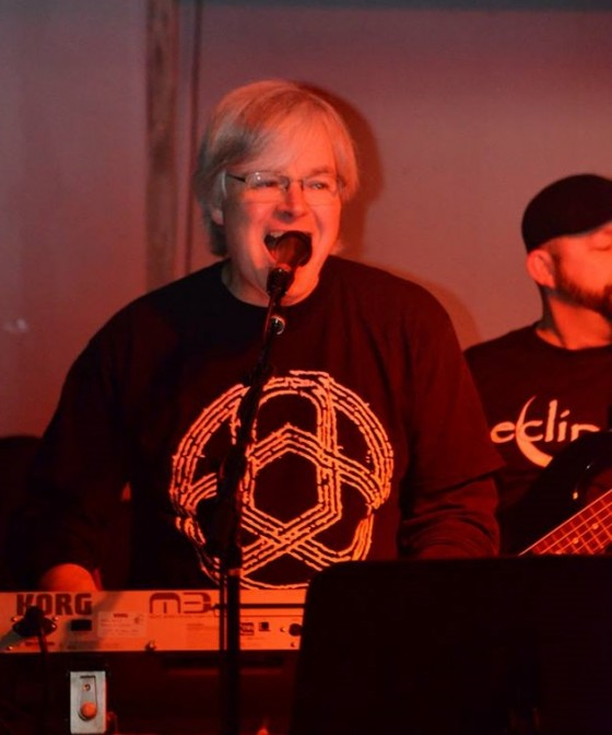 Wes Ostiguy wearing a Circuline shirt at one of his gigs with Eclipse