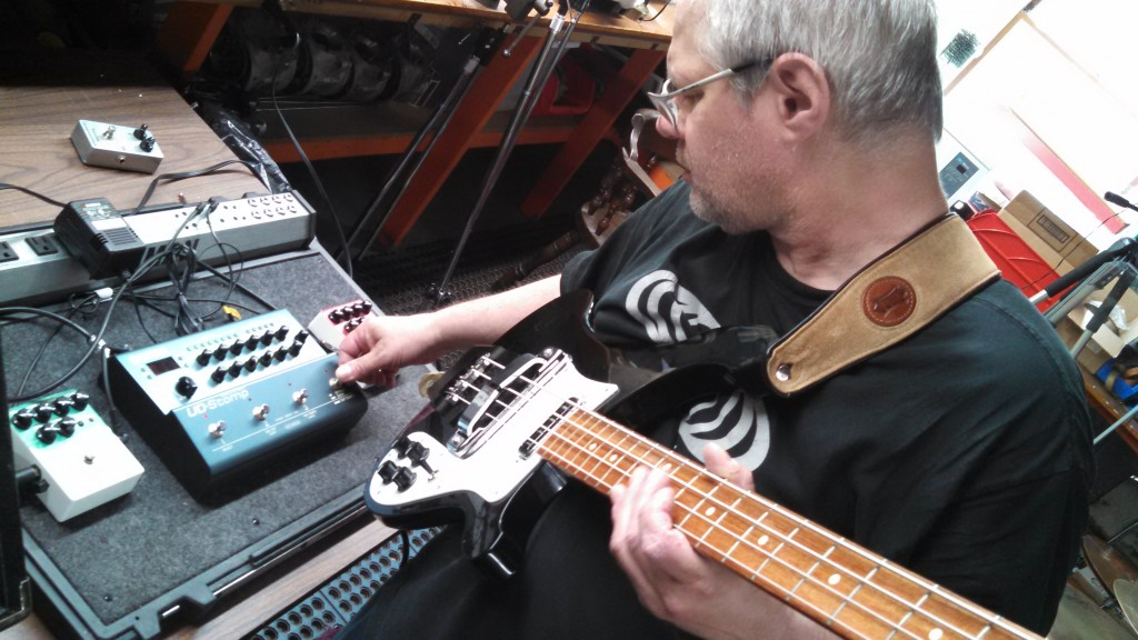Circuline bassist/composer/vocalist Daniel Aggers tweaking the effects on his rig.