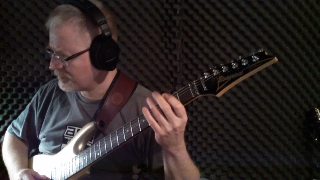 Bill Shannon works out his guitar parts in The Cave.