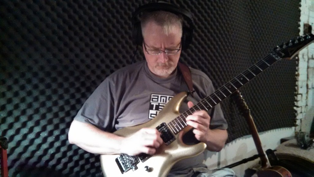 Bill Shannon laying down rough guitar tracks in The Cave.