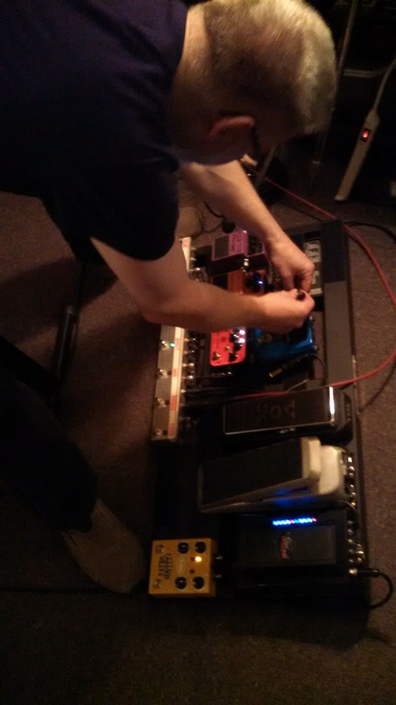 Bill Shannon, fiddling with his pedalboard.