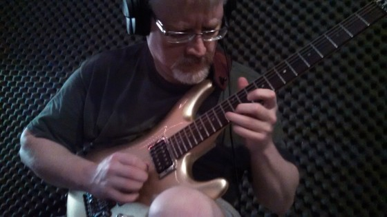 Bill Shannon working on new guitar parts in The Cave.