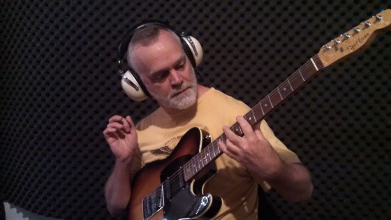 "William ""Billy"" Spillane working on guitar parts for Circuline's second album."