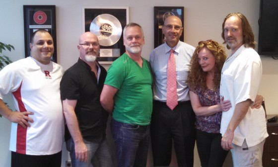 "Circuline manager Thomas Palmieri, Darin Brannon, William ""Billy"" Spillane, attorney Ronald Bienstock, Natalie Brown, and Andrew Colyer. Absent from the photo is bassist Paul Ranieri."